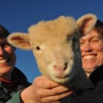 Smallholding course attendees with lamb at Humble by Nature