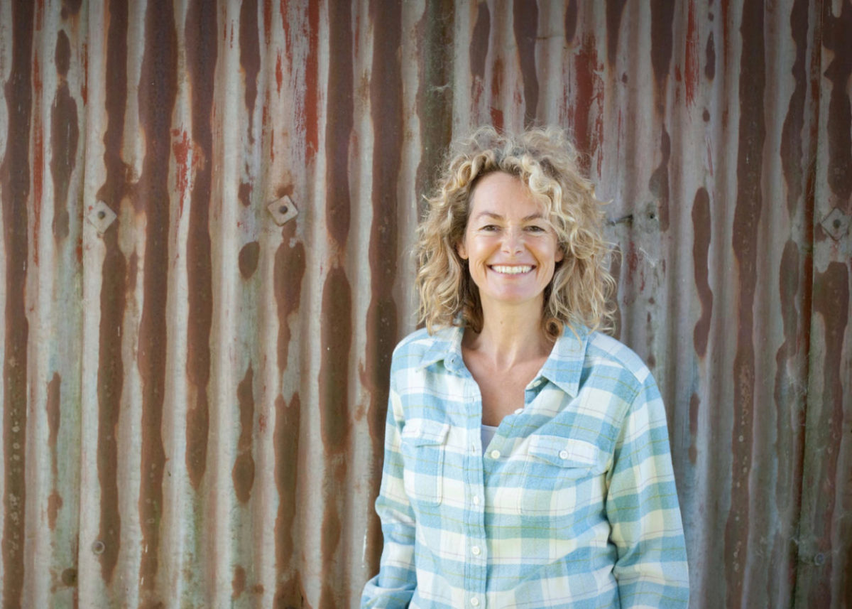 Kate Humble in front of the dutch barn